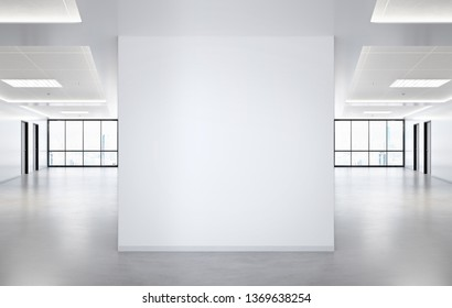 Blank squared wall in bright office mockup with large windows and sun passing through 3D rendering