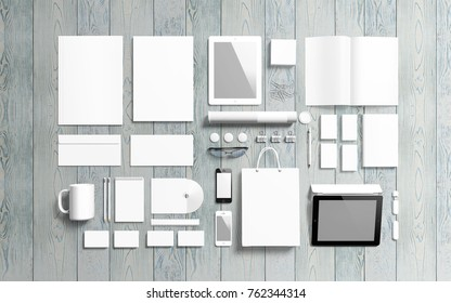 Blank stationery set on wooden background. Branding elements to showcase your presentation. 3d render.
