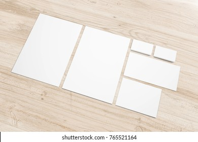 Blank stationery set on wooden background. 3d render. Template to showcase your presentation.