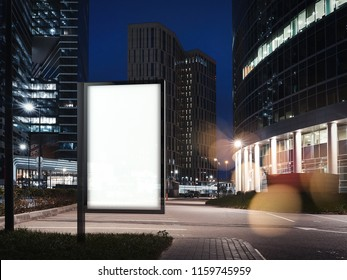 Blank white illuminated banner at night time near to skyscrapers and parking. 3d rendering