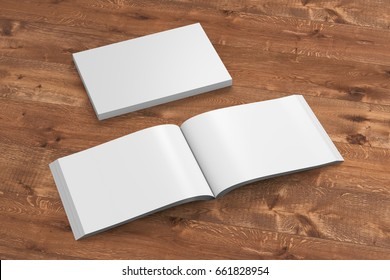 Blank white landscape soft cover book with glossy paper on wooden background. Open and closed, isolated with clipping path around each book. 3d illustration