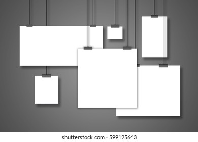 Blank white many page hanging on the two clothespins with a string. Isolated on a gray background