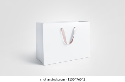 Blank white paper bag with silk handle mockup, isolated, 3d rendering. Beautiful craft plastic package mock up. Empty gift carry pack template. Shopping packet mock-up.