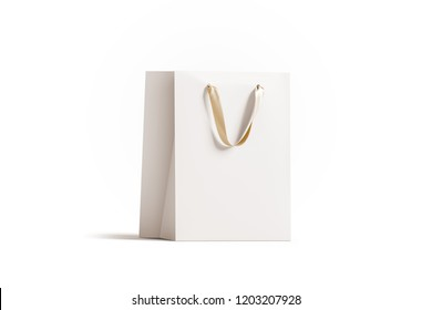Blank white paper gift bag with gold silk handle mockup, 3d rendering. Empty shopping packet mock up, isolated. Clear plastic bag for purchase or present. Beautiful craft package template.