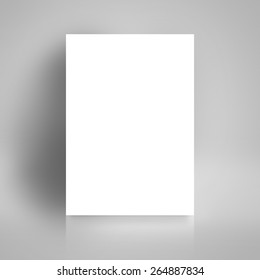 Blank White Paper Poster Leaning on White Studio Room Wall as Copy Space for Design and Template Mock up for Adding Your Text.
