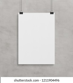 Blank white poster hanging up with in front of concrete wall clips mockup