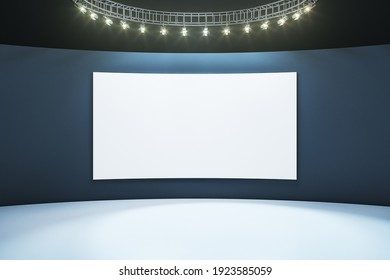 Blank white poster on dark wall in empty hall room with light floor and led lights on top. Mockup. 3D rendering
