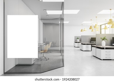 Blank white poster on glass wall in modern open space office with grey furniture and yellow lights. Mockup. 3D rendering