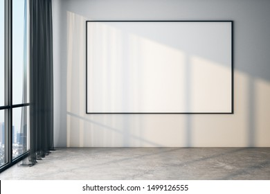 Blank white poster on white wall in modern empty room with big windows and concrete floor, mock up. 3D Rendering
