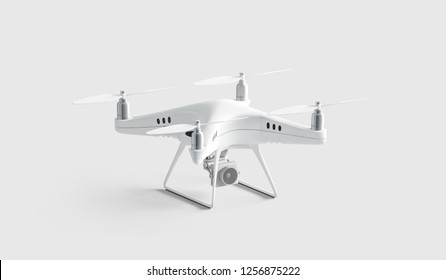 Blank white quadcopter mock up, stand isolated, 3d rendering. Empty air drone mockup, side view. Clear wireless helicopter for shooting or shadowing template. Technology toy with airscrew.