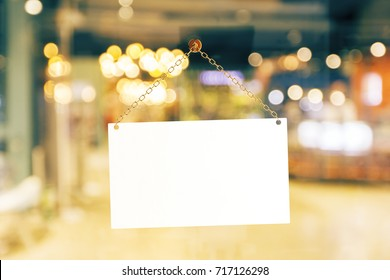 Blank white retail store sign on blurry background. Advertising concept. Mock up, 3D Rendering