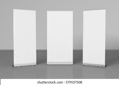 Blank white roll up banner stands on gray floor. With clipping paths around stands and ad banners. 3d illustration