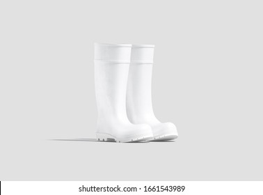 Blank white rubber wellington boots mock up, half-turned view, 3d rendering. Empty wellingtons gumboot pair mockup, isolated. Clear silicone footwear for rain weather or worker protect template.