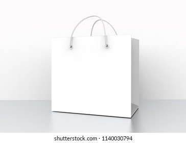 Blank white shopping bag with nylon rope handle on the floor