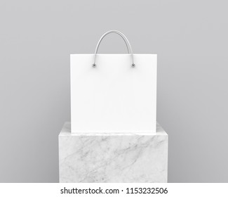 Blank white shopping bag with nylon rope handle on marble stone square column