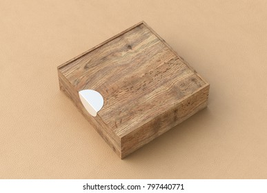 Blank wooden square box with closed sliding lid on beige leather background. Include clipping path around box. 3d illustration