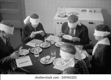 Blindfolded meat testers sampling meats produced on an experimental farm in Prince George's County, Maryland. August 1935 photo by Carl Mydans.