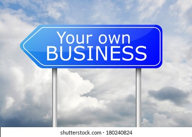 """Blue arrow post sign """"Your own business"""" over the blue sky"""