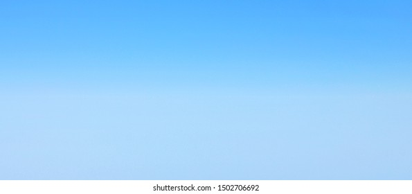 Blue background with empty copyspace on plain bright bluish surface. Wide abstract banner with soft gradient blue texture