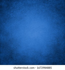 Blue background with texture, distressed scratched black lines on blue background in a leather style texture illustration, light center and dark border design, abstract grunge pattern