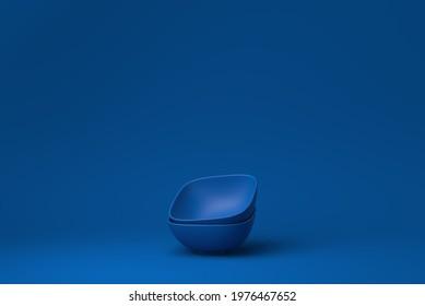 Blue bowls in blue background. minimal concept idea creative. monochrome. 3D render.
