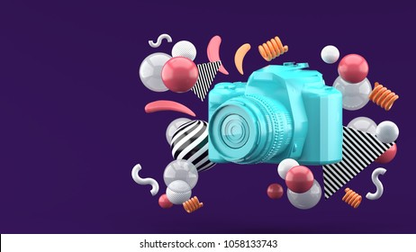 Blue camera surrounded by colorful balls on a purple background.-3d render.