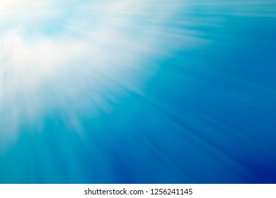 Blue color background with ray light from top left corner.
