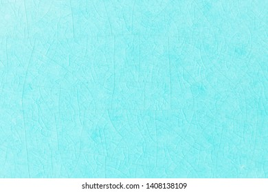 Blue crack ceramic tile. Sea color of glazed tile texture abstract background. Texture of turquoise crackle glass mosaic tile.