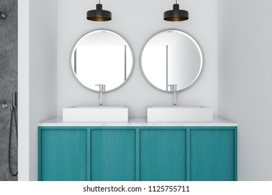 Blue double vessel sink standing in a modern bathroom interior with a wooden countertop and two round mirrors. 3d rendering mock up