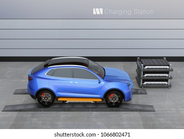 Blue electric SUV car in battery swapping station. Pack of batteries on the left side of the car.  3D rendering image.