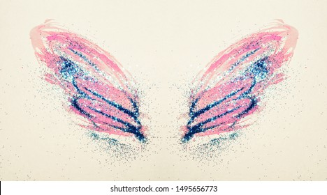 Blue glitter on abstract pink watercolor wings in vintage nostalgic colors, beautiful shiny feathers
