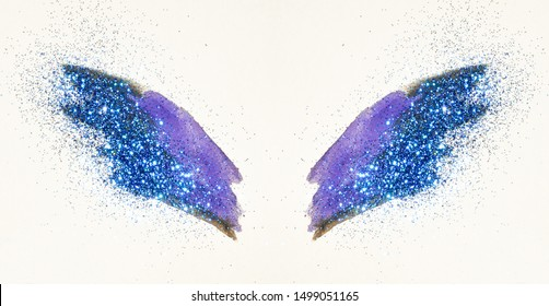 Blue glitter on abstract purple watercolor wings, beautiful shiny feathers