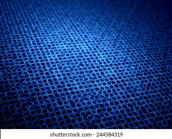 Blue glowing microlenses in mesh, computer generated abstract background
