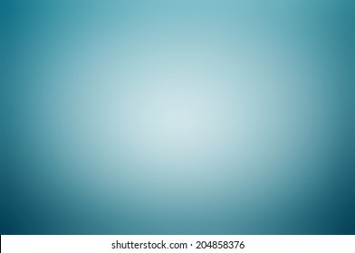Blue gray gradient abstract background with white light at the center