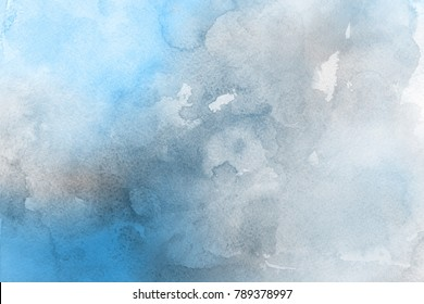 Blue with gray and white realistic watercolor texture on paper background.