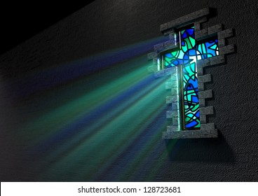 A blue and green patterned stain glass window in the shape of a crucifix with a spotlight shining through it