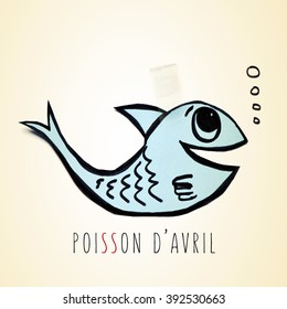 a blue handmade paper fish attached with adhesive tape and the text poisson d avril, april fools day in french