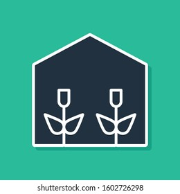 Blue Home greenhouse and plants icon isolated on green background.