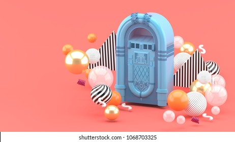 Blue jukebox among colorful balls on a pink background.-3d render.
