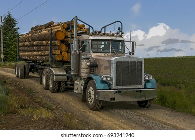 A blue logging truck on a dusty road transporting wooden logs to a lumber mill.