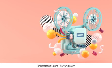 Blue movie projector amid colorful balls on pink background.-3d render.