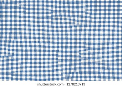Blue picnic blanket fabric with squared patterns and texture