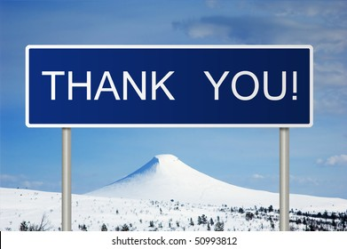 A blue road sign with white text saying Thank You!