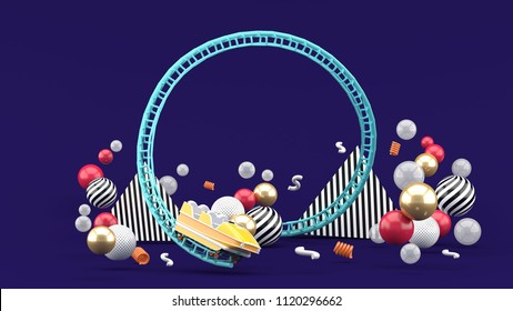 A blue roller coaster among colorful balls on a purple background.-3d rendering.