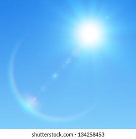 Blue sky with glaring sun