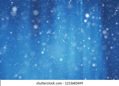 blue snow lines background / abstract background christmas blue snowflakes blurred background, snow flakes