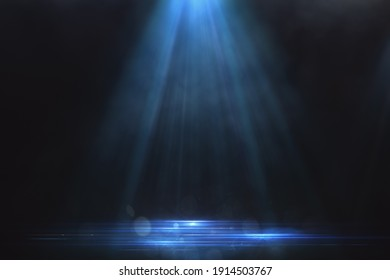 Blue spotlight background and glowing electric blue lines on the floor with smoke