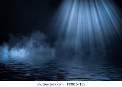 Blue spotlight smoke with reflection in water. Mistery fog texture overlays background