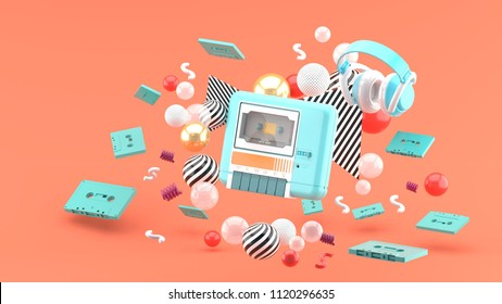 An blue tape player surrounded by tapes and colorful balls on a pink background.-3d rendering.