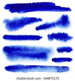 Blue watercolor paint strokes on white background